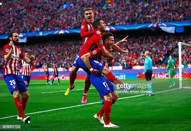 Saul Niguez of Atletico Madrid celebrates with team mates as he scores their first goal during the UEFA Champions League semi final first leg match...