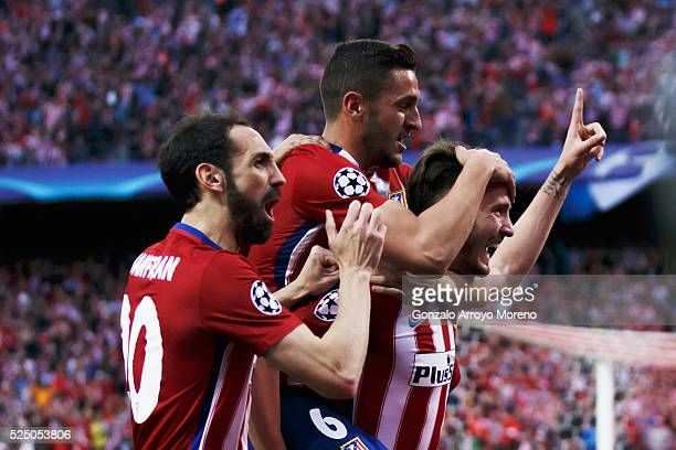 Saul Niguez of Atletico Madrid celebrates with team mates Juanfran and Koke as he scores their first goal during the UEFA Champions League semi final...