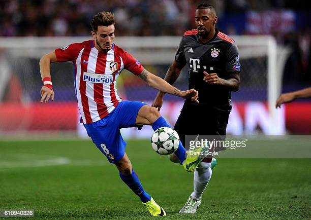 Saul Niguez of Atletico Madrid controls the ball under pressure from Jerome Boateng of Bayern Muenchen during the UEFA Champions League group D match...