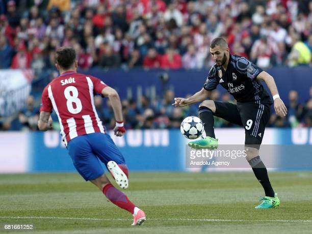 Saul Niguez of Atletico Madrid in action against Karim Benzema of Real Madrid during the UEFA Champions League semi final second leg match between...