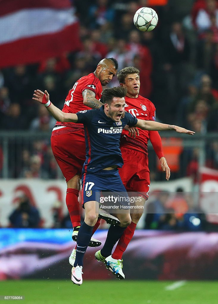 Saul Niguez of Atletico Madrid (17) jumps with <a gi-track='captionPersonalityLinkClicked' href=/galleries/search?phrase=Arturo+Vidal&family=editorial&specificpeople=2223374 ng-click='$event.stopPropagation()'>Arturo Vidal</a> (L) and Thomas Mueller of Bayern Munich (R) during UEFA Champions League semi final second leg match between FC Bayern Muenchen and Club Atletico de Madrid at Allianz Arena on May 3, 2016 in Munich, Germany.