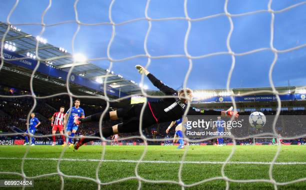 Saul Niguez of Atletico Madrid scores his sides first goal past Kasper Schmeichel of Leicester City during the UEFA Champions League Quarter Final...