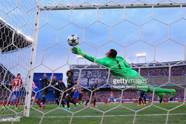Saul Niguez of Atletico Madrid scores the opening goal past goalkeeper Keylor Navas of Real Madrid during the UEFA Champions League Semi Final second...