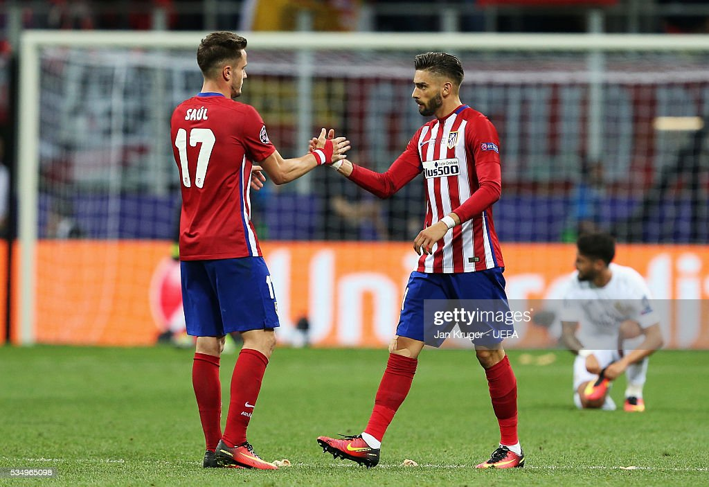 Saul Niguez of Atletico Madrid shakes the hand of Yannick Carrasco of Atletico Madrid during the UEFA Champions League Final between Real Madrid and Club Atletico de Madrid at Stadio Giuseppe Meazza on May 28, 2016 in Milan, Italy.