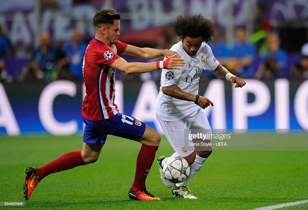 Saul Niguez of Atletico Madrid tackles <a gi-track='captionPersonalityLinkClicked' href=/galleries/search?phrase=Marcelo+-+Attacking+Left+Back+-+Born+1988&family=editorial&specificpeople=2136789 ng-click='$event.stopPropagation()'>Marcelo</a> of Real Madrid during the UEFA Champions League Final between Real Madrid and Club Atletico de Madrid at Stadio Giuseppe Meazza on May 28, 2016 in Milan, Italy.
