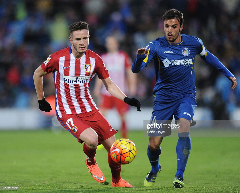 Saul Niguez of Club Atletico de Madrid battles for the ball against <a gi-track='captionPersonalityLinkClicked' href=/galleries/search?phrase=Pedro+Leon&family=editorial&specificpeople=4818187 ng-click='$event.stopPropagation()'>Pedro Leon</a> of Getafe during the La Liga match between Getafe CF and Club Atletico de Madrid at Coliseum Alfonso Perez on February 14, 2016 in Getafe, Spain.