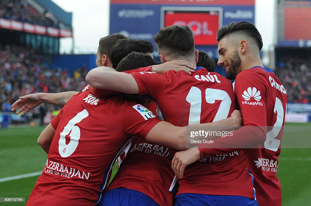 Saul Niguez of Club Atletico de Madrid celebrates with teammates after scoring his team's 2nd goal during the La Liga match between Club Atletico de Madrid and SD Eibar at Vicente Calderon Stadium on February 6, 2016 in Madrid, Spain.