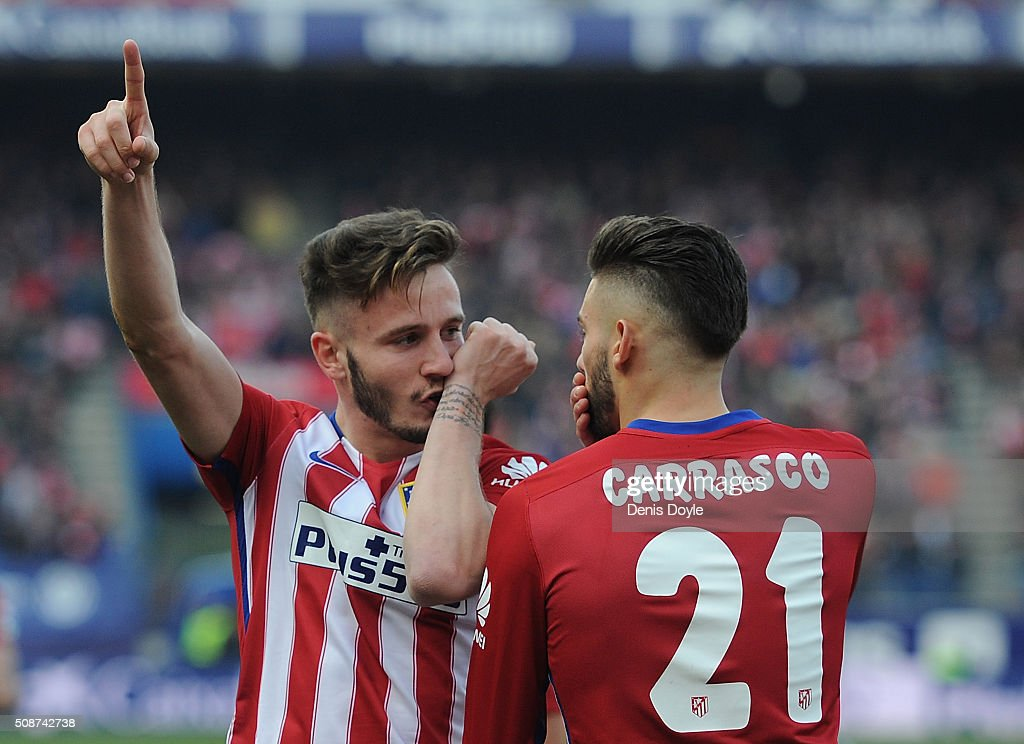 Saul Niguez of Club Atletico de Madrid celebrates with Yannick Carrasco after scoring his team's 2nd goal during the La Liga match between Club Atletico de Madrid and SD Eibar at Vicente Calderon Stadium on February 6, 2016 in Madrid, Spain.
