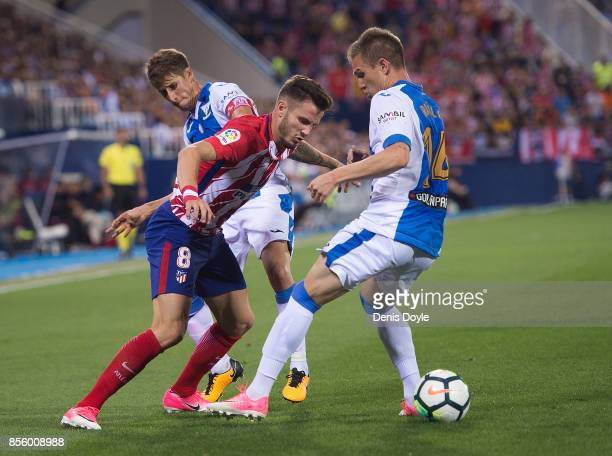Saul Niguez of Club Atletico de Madrid is tackled by Raul Garcia of CD Leganes during the La Liga match between Leganes and Atletico Madrid at...