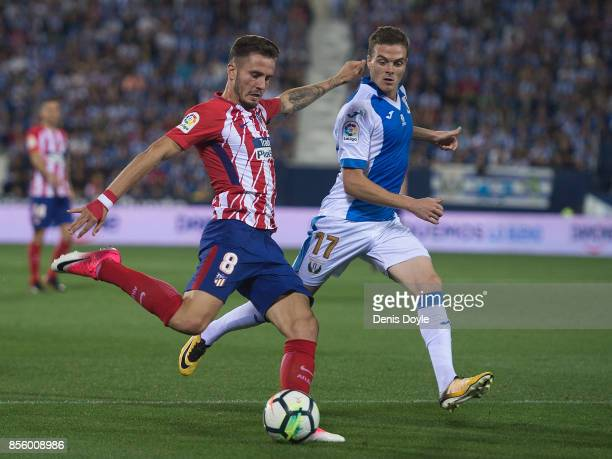 Saul Niguez of Club Atletico de Madrid shoots past Javier Eraso of CD Leganes during the La Liga match between Leganes and Atletico Madrid at Estadio...