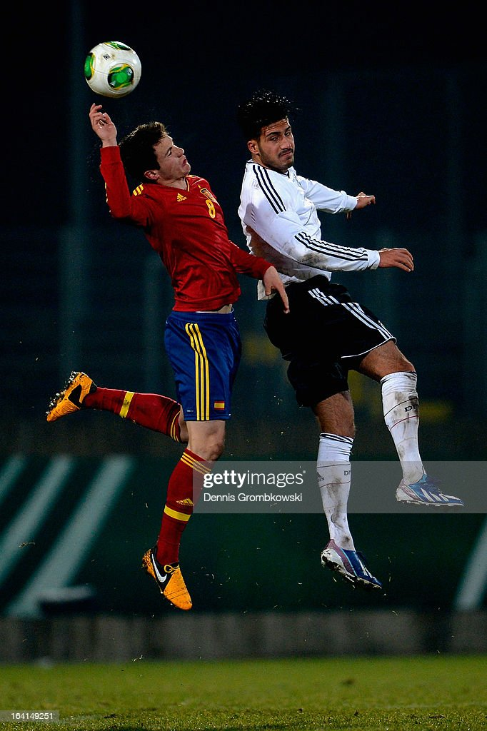Saul Niguez of Spain and <a gi-track='captionPersonalityLinkClicked' href=/galleries/search?phrase=Emre+Can&family=editorial&specificpeople=5909273 ng-click='$event.stopPropagation()'>Emre Can</a> of Germany go up for a header during the International Friendly match between U19 Germany and U19 Spain on March 20, 2013 in Duesseldorf, Germany.