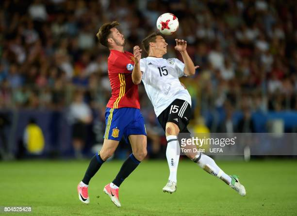 Saul Niguez of Spain and MarcOliver Kempf of Germany in action during the UEFA European Under21 Championship Final between Germany and Spain at...