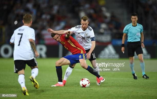 Saul Niguez of Spain and Max Arnold of Germany during their UEFA European Under21 Championship 2017 final match on June 30 2017 in Krakow Poland