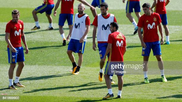 Saul Niguez of Spain Andres Iniesta of Spain Sergio Busquets of Spain Pedro Rodríguez of Spain and Álvaro Morata looks on during a training session...