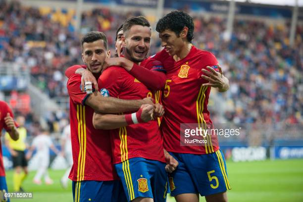 Saul Niguez of Spain celebrates his score with his teammate during the UEFA Under 21 Championship Group B match between Spain and FYR Macedonia at...