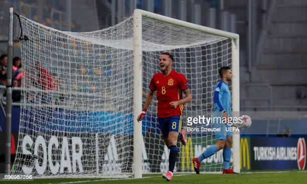 Saul Niguez of Spain celebrates with team mates after scoring his team's first goal during the UEFA European Under21 Championship match between Spain...