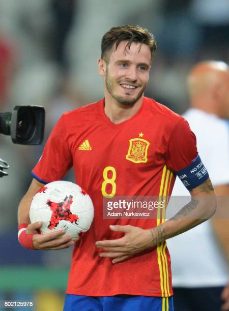 Saul Niguez of Spain collects the match ball for his hatrick during the UEFA European Under21 Championship Semi Final match between Spain and Italy...