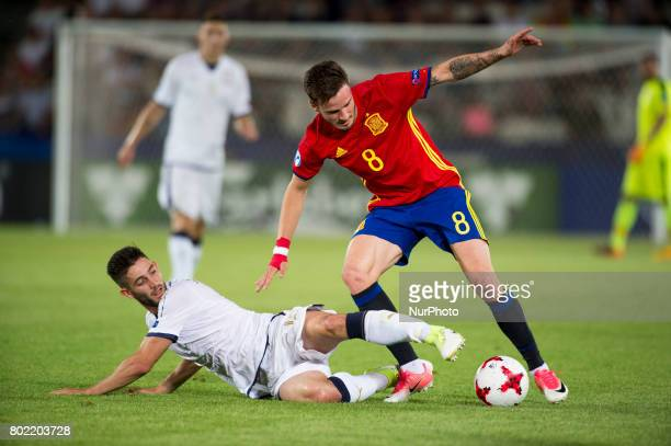 Saul Niguez of Spain fights for the ball with Roberto Gagliardini of Italy during the UEFA European Under21 Championship SemiFinal match between...