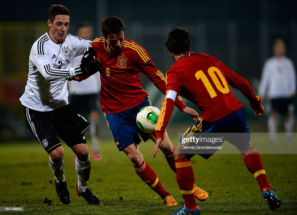 Saul Niguez of Spain is challenged by Dominik Kohr of Germany during the International Friendly match between U19 Germany and U19 Spain on March 20, 2013 in Duesseldorf, Germany.