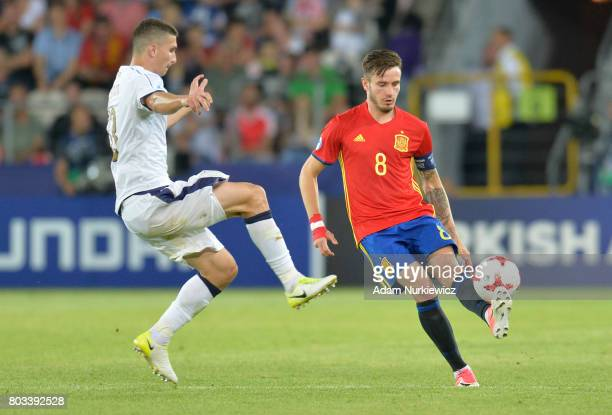 Saul Niguez of Spain is challenged by Mattia Caldara of Italy during the UEFA European Under21 Championship Semi Final match between Spain and Italy...