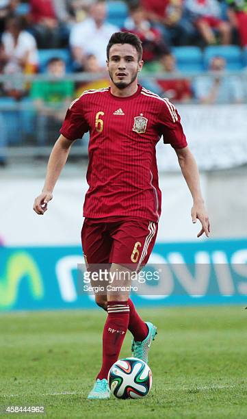 Saul Niguez of Spain runs with the ball during the UEFA European Under21 Championship playoff second leg match between Spain and Serbia at the...