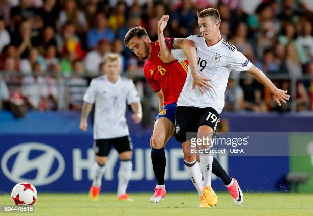 Saul Niguez of Spin and Janik Haberer of German battle for possession during the UEFA European Under21 Championship Final between Germany and Spain...