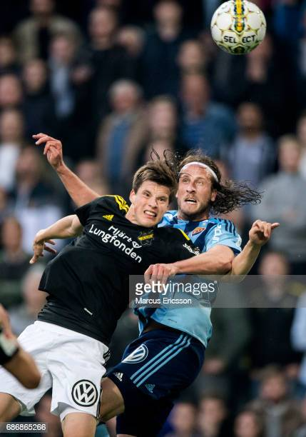 Sauli Vaisanen of AIK and Jonas Olsson of Djurgardens IF during the Allsvenskan match between Djurgardens IF and AIK at Tele2 Arena on May 22 2017 in...
