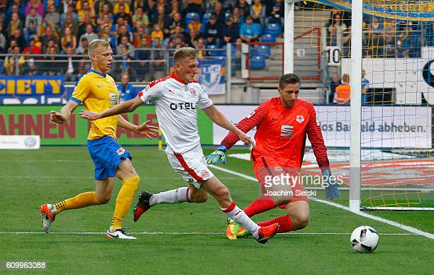 Saulo Decarli and Jasmin Fejzic of Braunschweig challenges Axel Bellinghausen of Duesseldorf during the Second Bundesliga match between Eintracht...