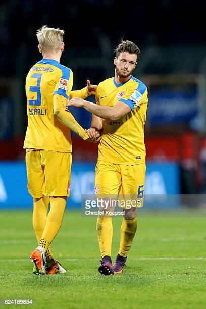 Saulo Decarli and Quirin Moll of Braunschweig look dejected after the Second Bundesliga match between VfL Bochum 1848 and Eintracht Braunschweig at...