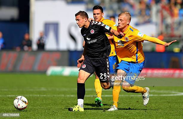 Saulo Decarli of Braunschweig challenges for the ball Sebastian Maier with of St Pauli during the Second Bundesliga match between Eintracht...