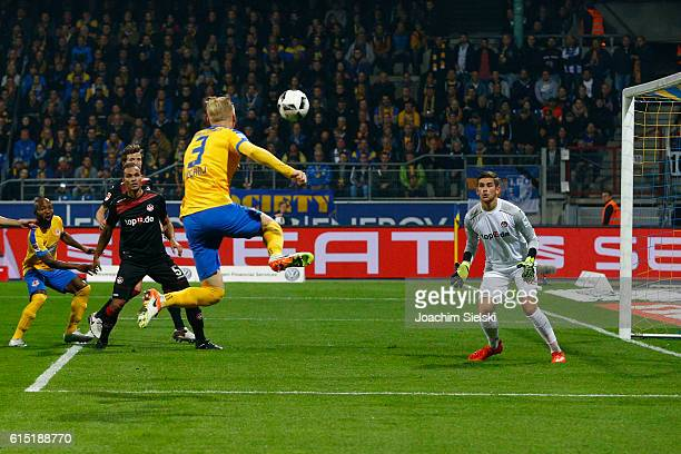 Saulo Decarli of Braunschweig challenges Julian Pollersbeck of Kaiserslautern during the Second Bundesliga match between Eintracht Braunschweig and 1...
