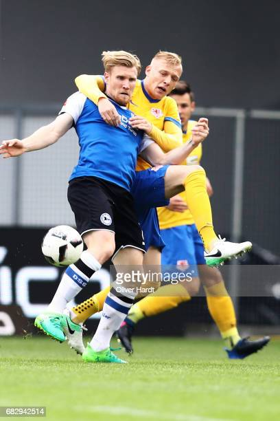 Saulo Igor Decarli of Braunschweig and Andreas Voglsammer of Bielefeld compete for the ball during the Second Bundesliga match between DSC Arminia...