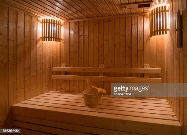 Sauna room with traditional sauna accessories for healthy.