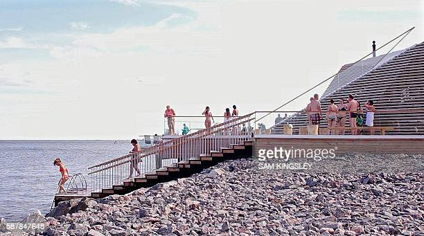 Saunagoers dip in the Baltic sea at the trendy new boutique sauna called Loyly in Helsinki on July 07 2016 In Finland despite an astounding two...