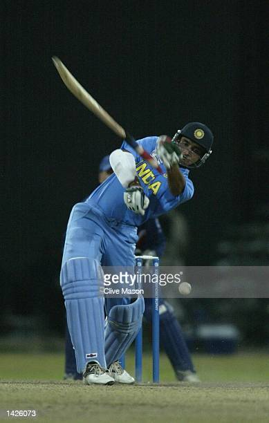 Saurav Ganguly of India lets go of his bat during the ICC Champions Trophy match between England and India at the Premadasa Stadium in Colombo Sri...