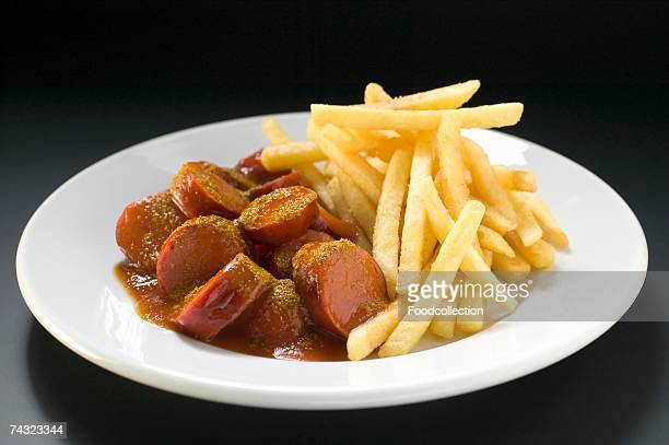 Sausage, cut into slices, with ketchup and chips