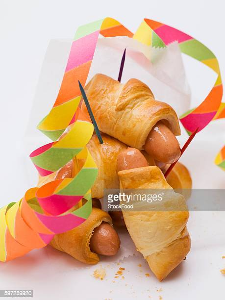 Sausage rolls with party decorations
