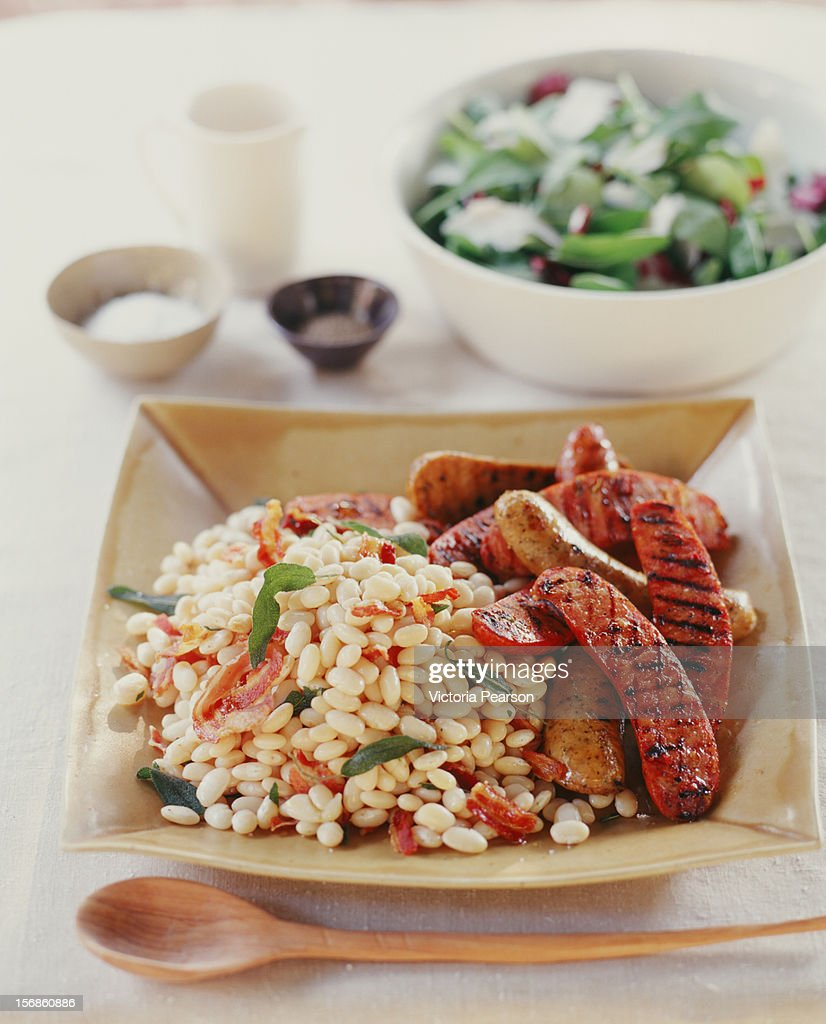 Sausage, white beans and salad greens. : Stock Photo