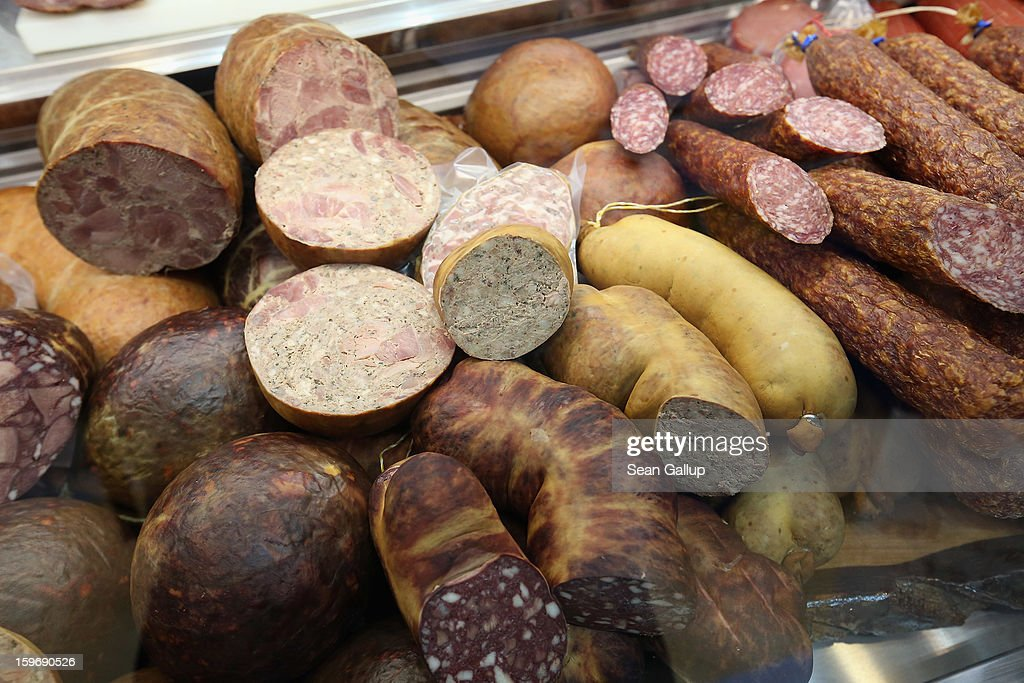 Sausages and wurst lie on display at a meat company's stand at the 2013 Gruene Woche agricultural trade fair on January 18, 2013 in Berlin, Germany. The Gruene Woche, which is the world's largest agricultural trade fair, runs from January 18-27, and this year's partner country is Holland. According to a recent study the average German consumes 1094 animals in his or her lifetime, including four cows, four sheep, 12 geese, 37 ducks, 46 turkeys, 46 pigs and 945 chickens.