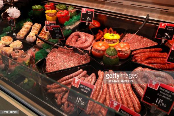 Sausages are pictired at an hypermarket store of French retail giant Carrefour in Villeneuvelagarenne near Paris on December 7 2016 / AFP / THOMAS...