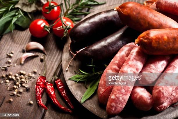 Sausages variation on dark wood table