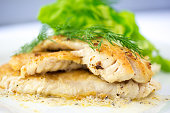 Pan Sauteed Canadian White Fish garnished with Dill Weed.
