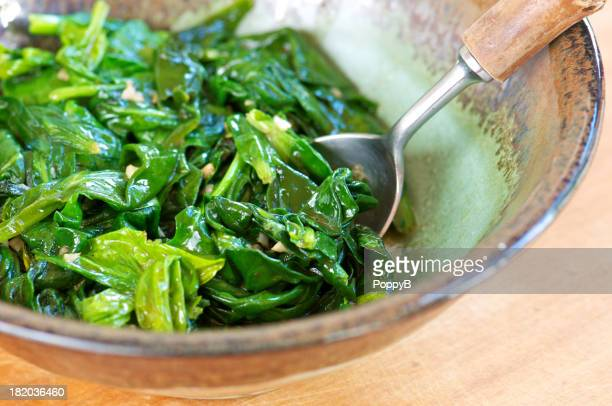 Sauteed Spinach with Garlic in Pottery Bowl