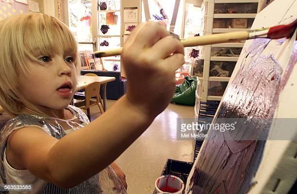 Savanah Anderson uses acrylic paints while painting on a stretched canvas at Roots and Wings Preschool in Thousand Oaks The school is planning an art...