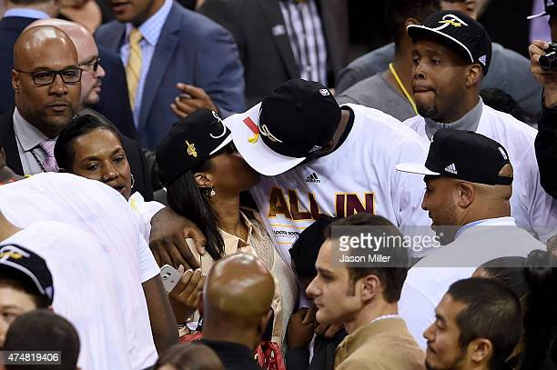 Savannah Brinson and LeBron James of the Cleveland Cavaliers celebrate after defeating the Atlanta Hawks during Game Four of the Eastern Conference...