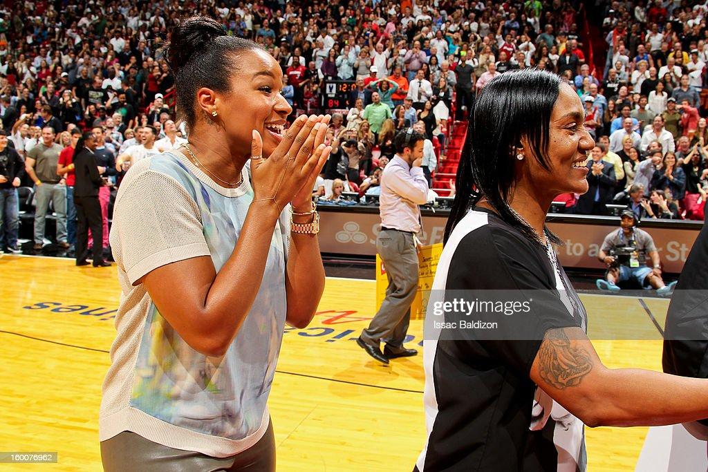 Savannah Brinson, fiancee of LeBron James of the Miami Heat, celebrates after fan Michael Drysch made a half-court shot to win $75,000 for himself and $75,000 for the LeBron James Family Foundation Boys and Girls Club of America during halftime of a game against the Detroit Pistons on January 25, 2013 at American Airlines Arena in Miami, Florida.