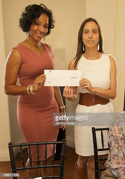 Savannah Brinson presents a check at Beats NBA AllStar Brunch For Ladies Benefiting The Step Up Women's Network Montage Beverly Hills on February 19...
