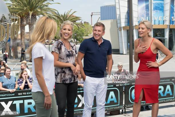 Savannah Chrisley Todd Chrisley and Charissa Thompson discuss Savannah's new clothing line at 'Extra' at Universal Studios Hollywood on July 18 2017...