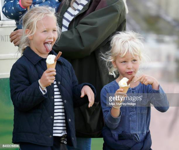 Savannah Phillips and Isla Phillips eat ice creams as they attend the Whatley Manor Horse Trials at Gatcombe Park on September 9 2017 in Stroud...