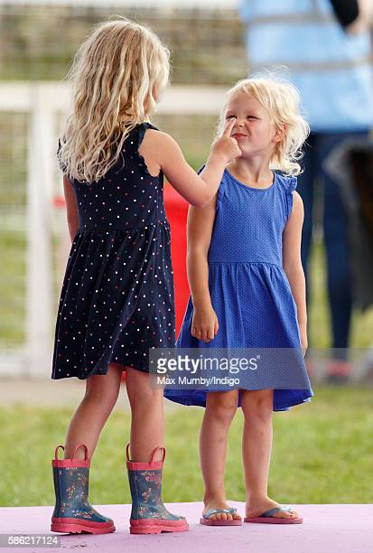 Savannah Phillips and Isla Phillips lark around as they attend day 1 of the Festival of British Eventing at Gatcombe Park on August 5 2016 in Stroud...